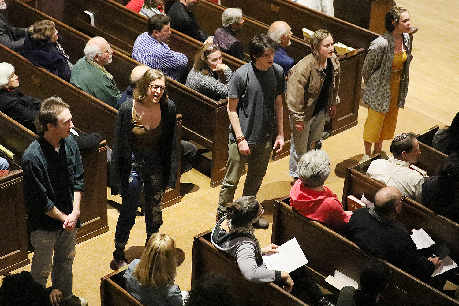 "The panel discussion was followed by a ticketed concert featuring the premiere performance of ""This Side of the Curtain."" The multimedia work was performed by more than 40 musicians and dancers from Wesleyan and the surrounding community, directed by Katja Kolcio."