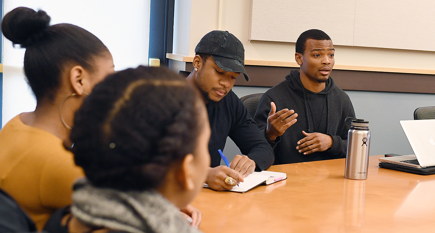 At right, Nate Taylor '18 speaks about his social enterprise, Nate Taylor Coaching. At his left is Jaylen Berry '18, founder and executive director of The Jaylen D. Berry Foundation.