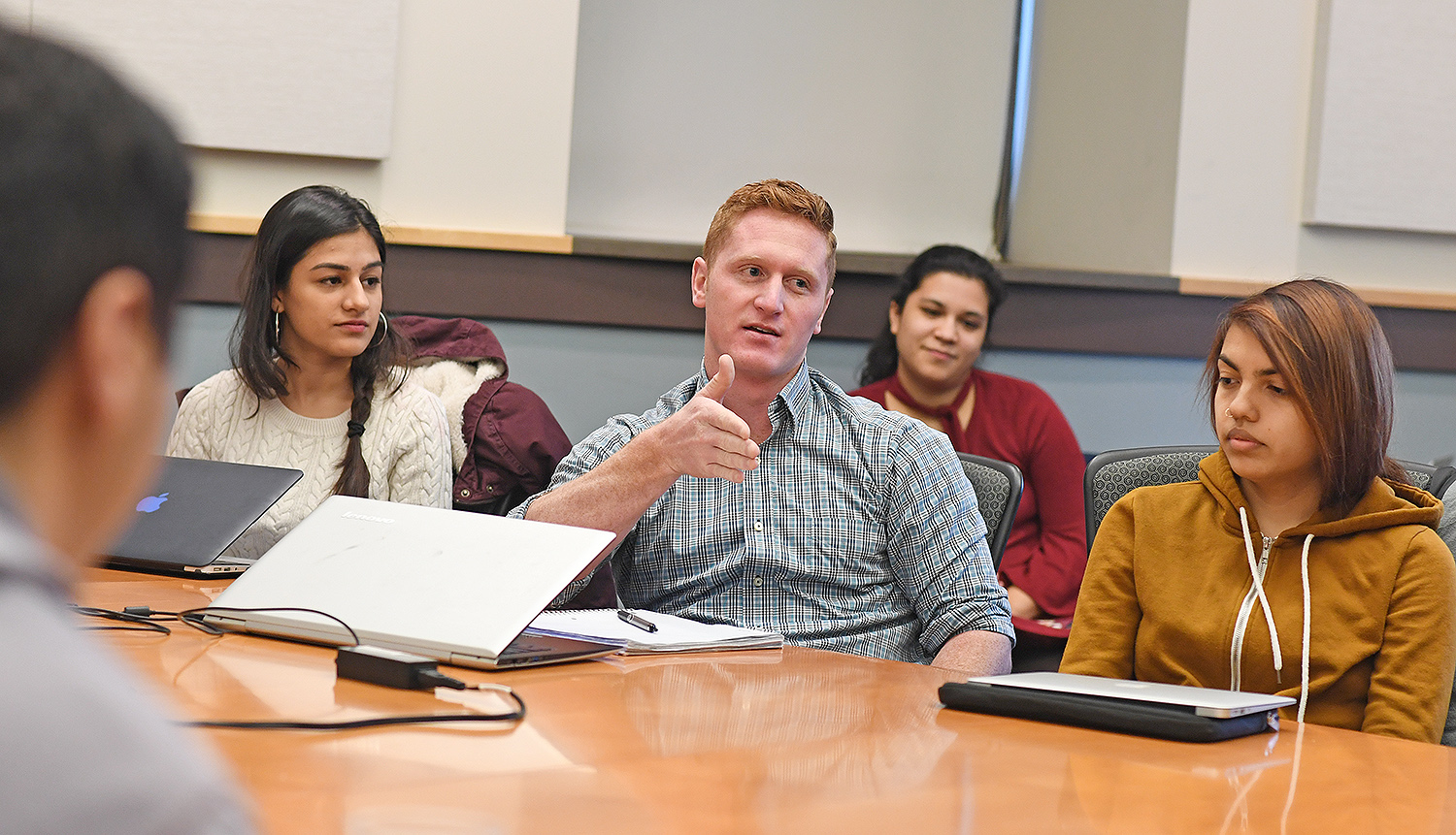 Wesleyan Posse Fellow Lance Williams '20 speaks about his role with the Wesleyan Design Tank, which uses human-centered design methodologies to facilitate problem-solving locally. Sankriti Malik '20, at left, also is involved with the Design Tank. Pictured in back is Rhea Drozdenko '18, the 2017/2018 Civic Engagement Fellow, and at right is Kelly Acevedo '20 who is creating Caput Productions through the Patricelli Center.