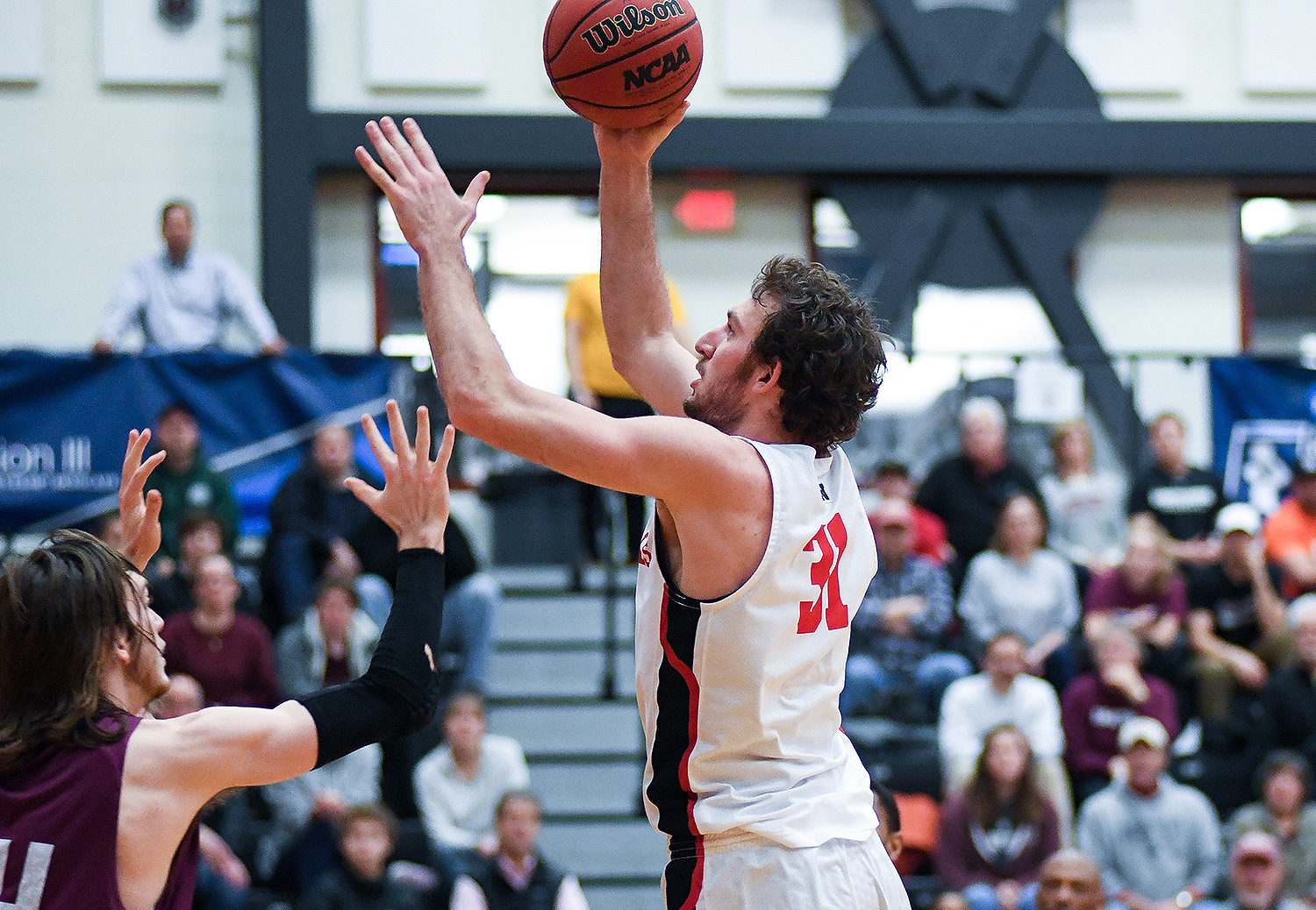 Nathan Krill '18 and the Wesleyan men's basketball team hosted first and second rounds of the NCAA Tournament on March 2-3 for the first time in program history. (Photo by Jonas Powell '18)