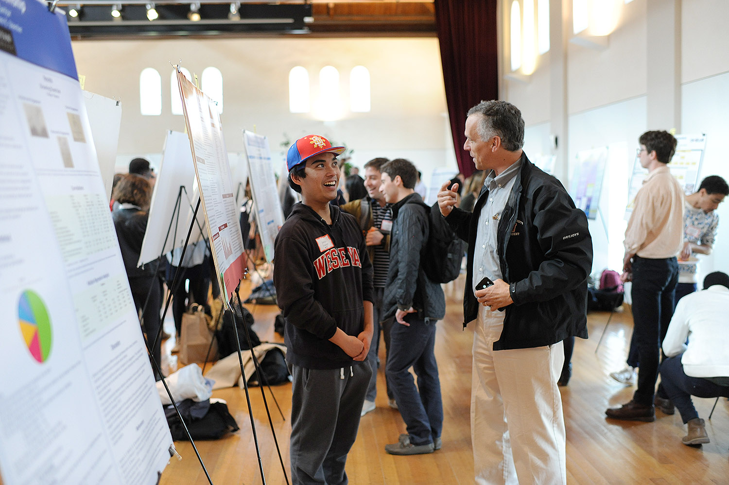 "Jordan Legaspi spoke to Wesleyan President Michael Roth about his poster titled ""The Purpose of Schooling: A Longitudinal Assessment."" Legaspi's advisor is Steven Stemler."