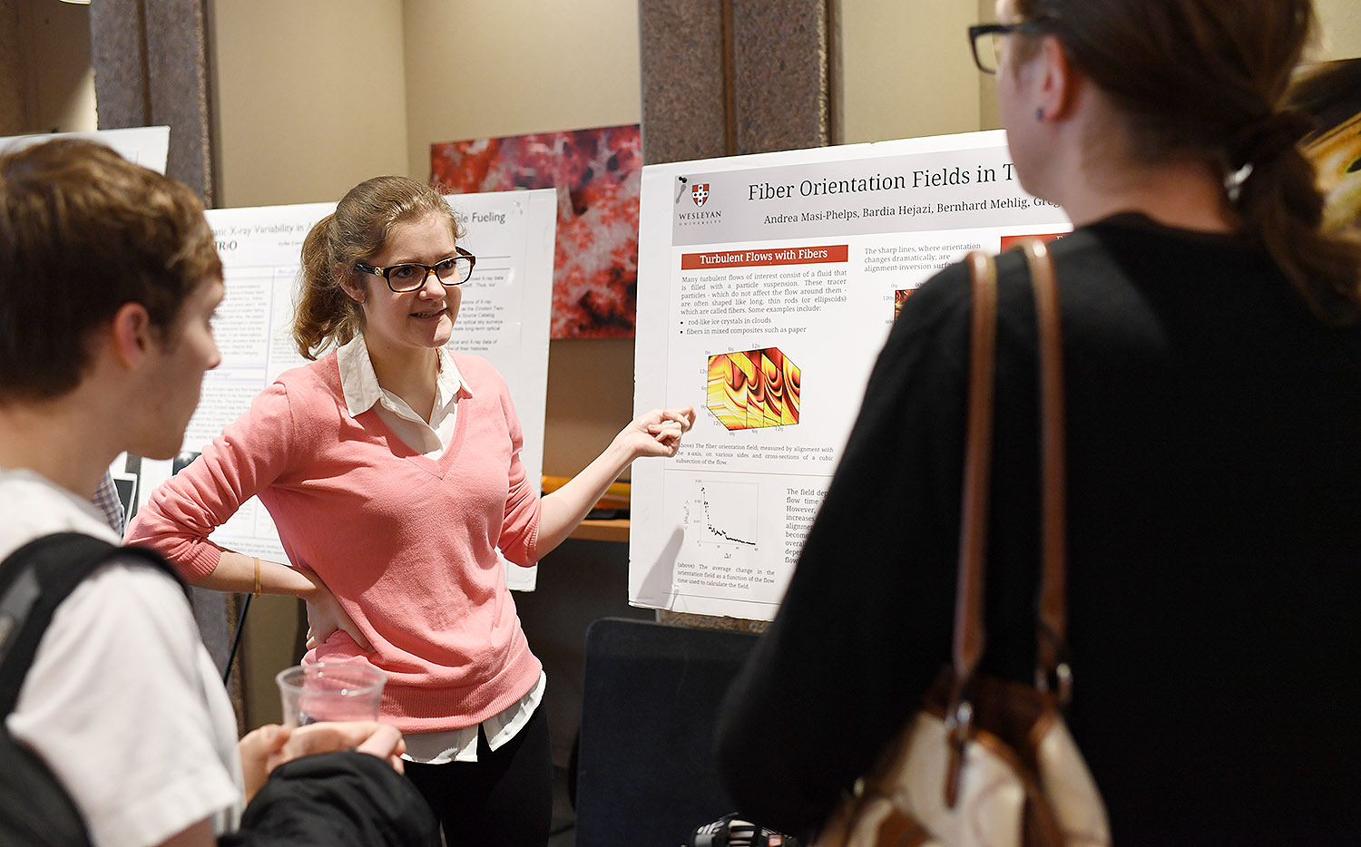 "Andrea Masi-Phelps shared her research titled ""Fiber Orientation Fields in Turbulence."" Her advisor is Greg Voth."