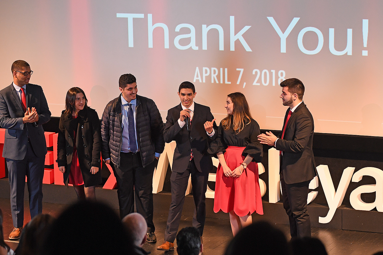 At left, Anthony Price '20, Zoe Reifel '21, Thafir Elzofri '19, Eunes Harun '20, Melisa Olgun '20 and Leo Merturi '20 thank the audience for attending Wesleyan's TEDxWesleyanU event on April 7.