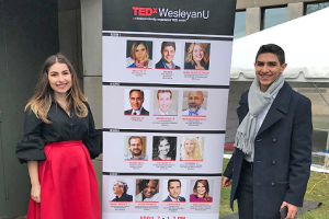 Melisa Olgun '20 and Eunes Harun '20 stand outside the Ring Family Performing Arts Hall while preparing for TEDxWesleyanU.