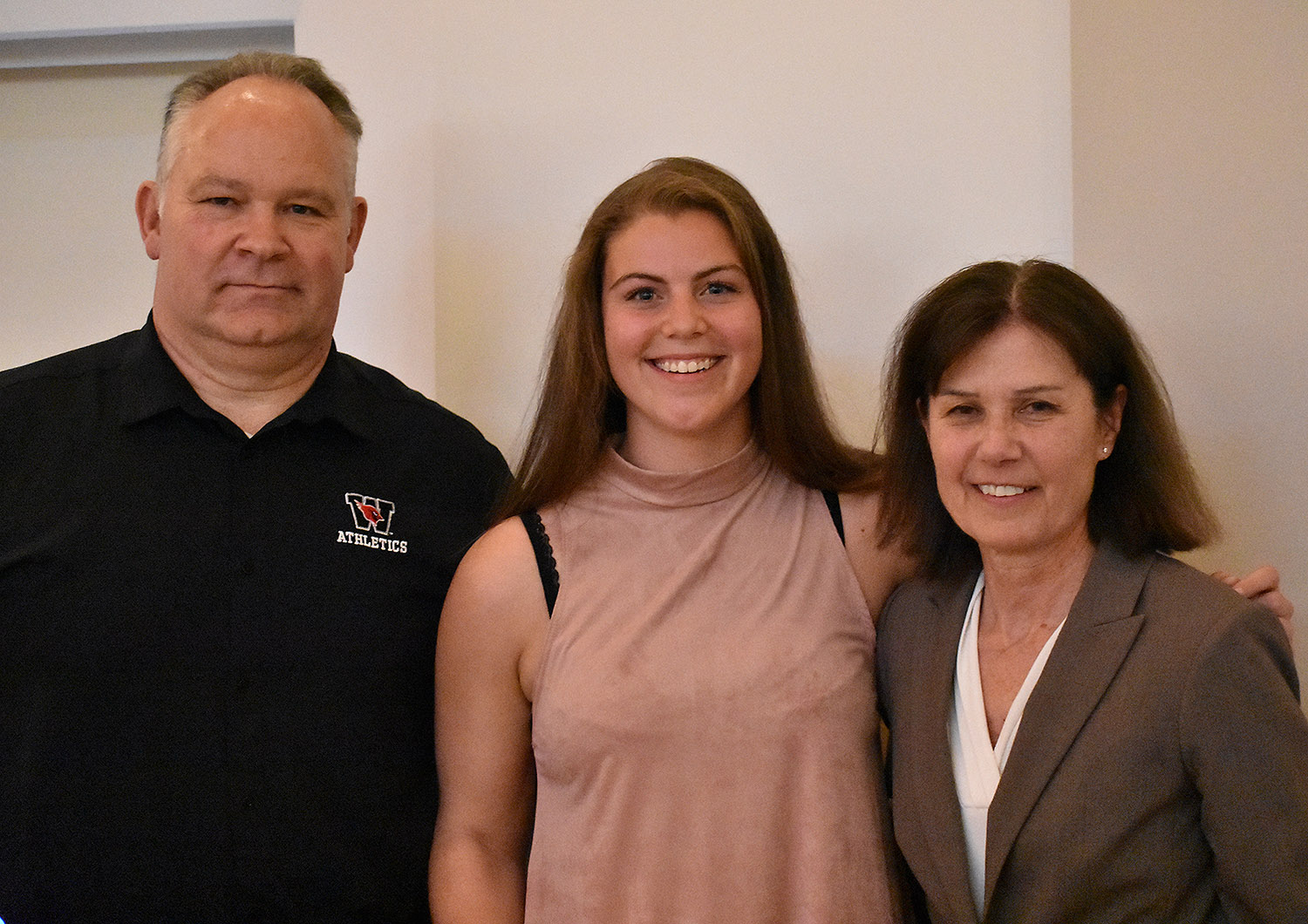 Basketball player Maddie Bledsoe '18 also received the Maynard Award. She is pictured with Whalen, left, and Kate Mullen, head women's basketball coach, right.