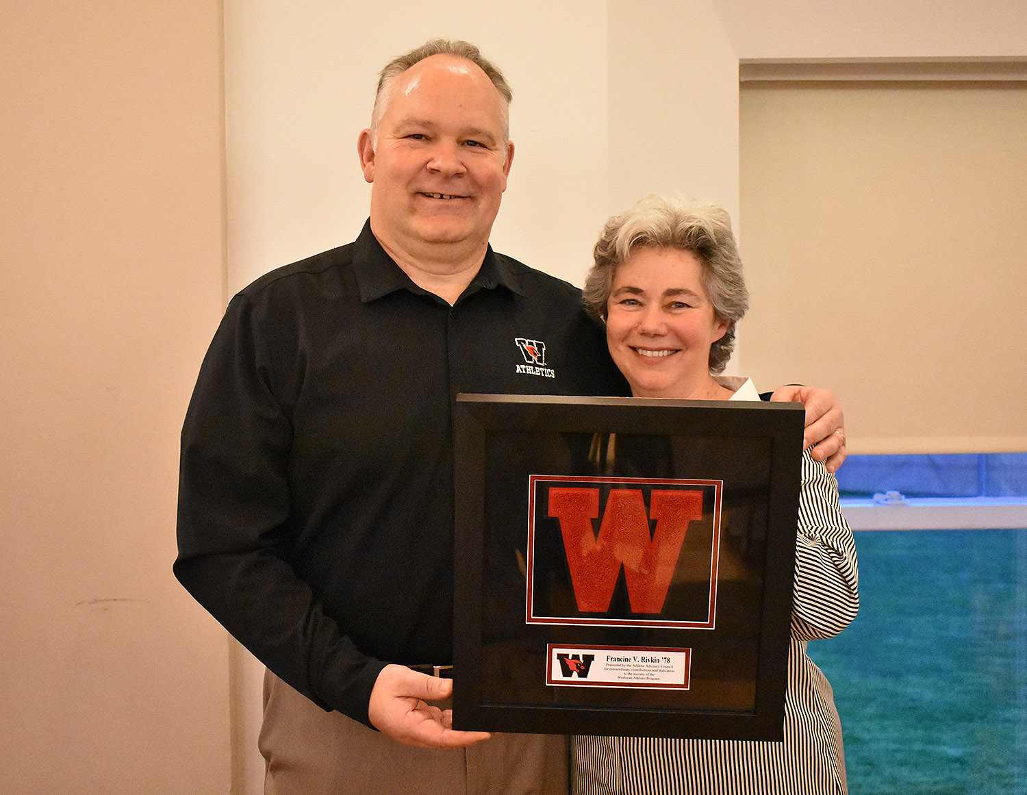 Francine Rivkin '78 was honored with the Cardinal Award, the Athletic Advisory Council's recognition of extraordinary contributions and dedication to the success of the Wesleyan Athlete Program. Rivkin is pictured with Mike Whalen, the Frank V. Sica Director of Athletics and chair of Physical Education, at left.