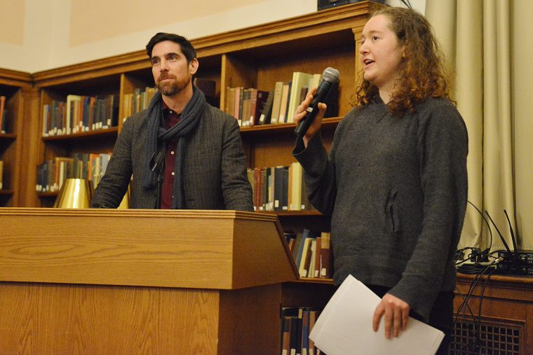 Elinor Weissberg '20 gives a summary of her paper, with Michael Meere, chair of the Friends. (Image courtesy of Caroline Kravitz)