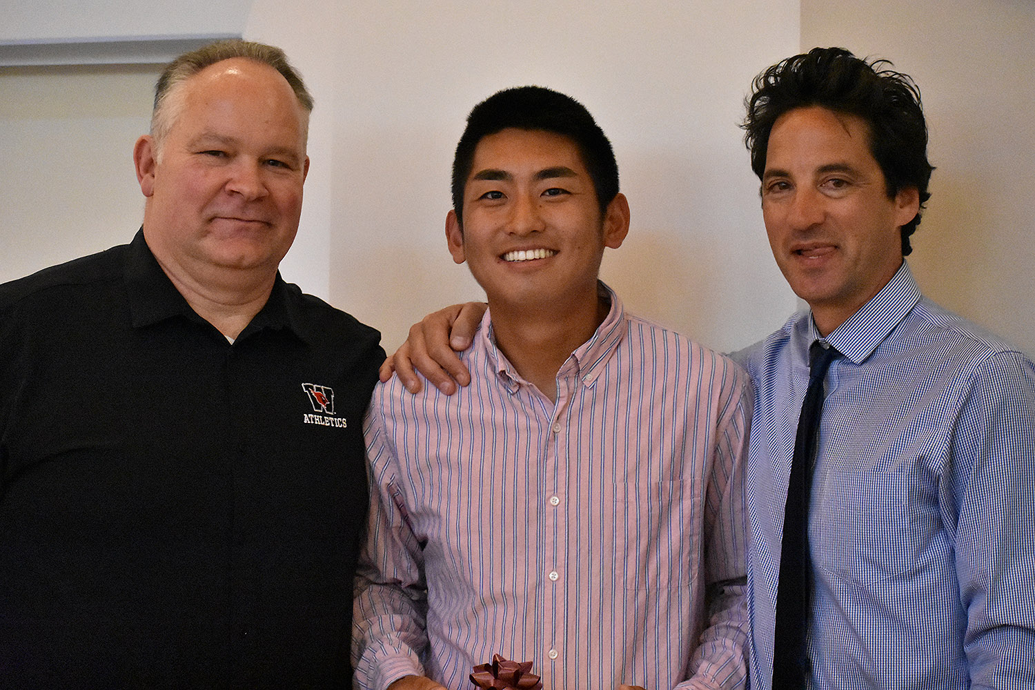 Tennis player Steven Chen '18 received the Maynard Award, which recognizes the top senior male and female scholar-athletes at the university. He is pictured with Whalen, left, and Mike Fried, head tennis coach, right. Along with Julie McDonald '18, Chen was also chosen by the administration to speak on behalf of student-athletes.