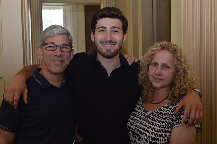Aaron Stagoff-Belfort '18, pictured with his parents, was co-editor-in-chief of the Argus in Fall 2017 and helped organize the 150th celebration.