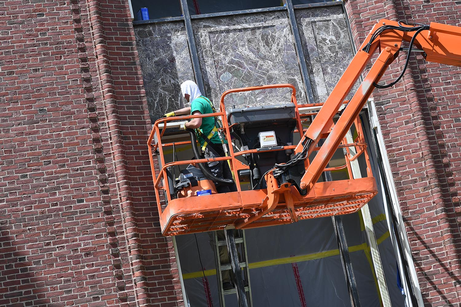 This summer, crews are working on restoring and repairing windows at Olin Library.