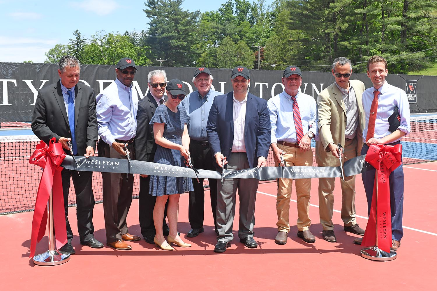 In 2017, Wesleyan and the City of Middletown partnered together on a project to rehabilitate and upgrade the Vine Street Tennis Courts. And on June 8, the courts were officially re-dedicated during a ribbon-cutting ceremony. Participants included William Russo, director of Middletown Public Works; Lorenzo Marshall, Middlesex Chamber of Commerce; Seb Giuliano, Common Council; Cathy Lechowicz, director of recreation and community services for the City of Middletown; Gerald Daley, Common Council; Daniel Drew, Mayor; Eugene Nocera, Common Council' Wesleyan President Michael Roth and State Representative Matt Lesser '10.