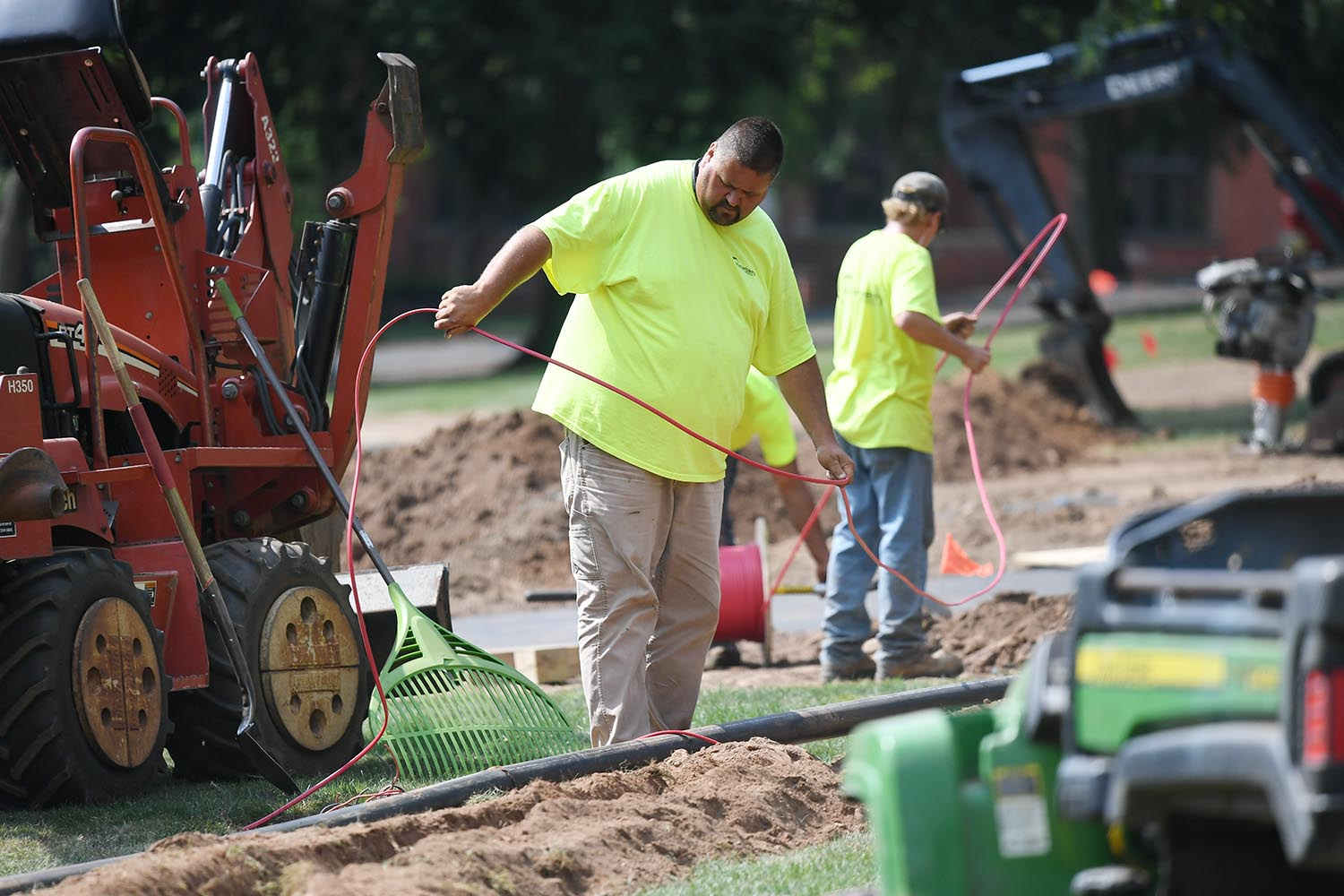 Crews install an irrigation system near College Row.