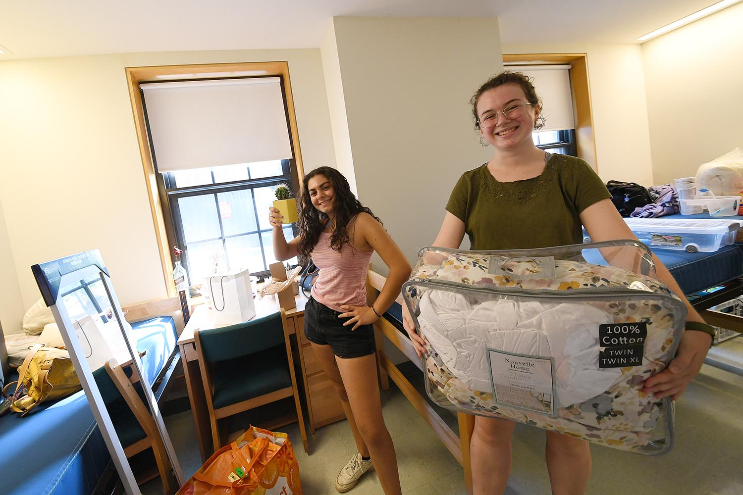 "Layla Krantz, from New York City, and Sarah Bozarian, from Dracut, Mass., set up their room in Clark. ""I liked everything about Wesleyan,"" says Bazarian, who is contemplatiing a major in either English or government and waiting to talk to her adviser about some potential changes in her schedule."