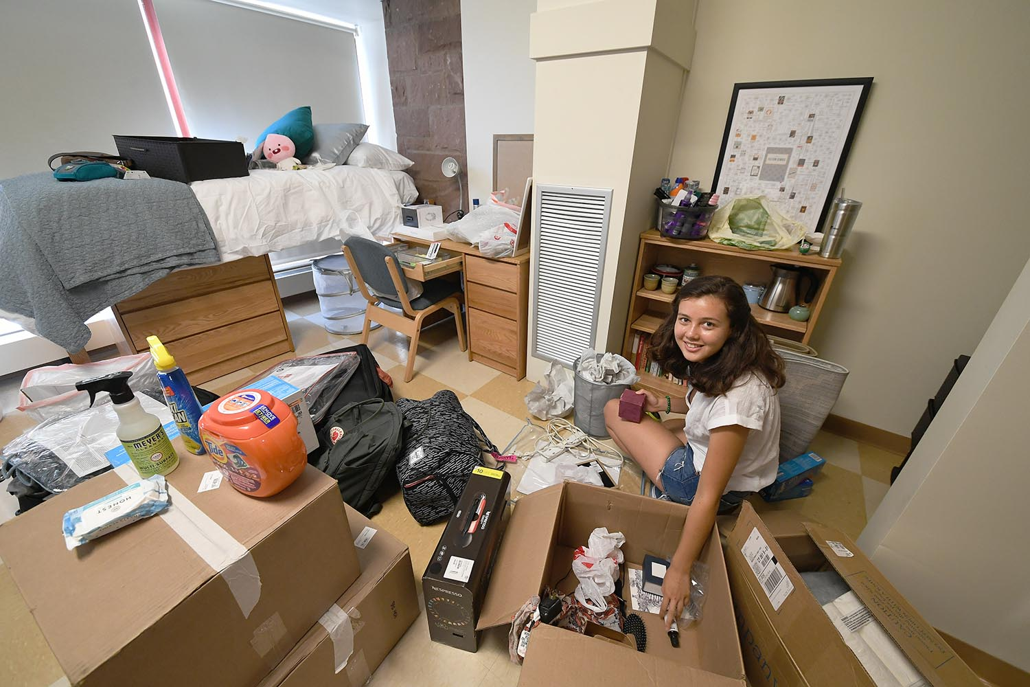 "Cambria Weaver '22 from Santa Barbara, Calif. sets up her room in the Butterfields. Weaver learned about Wesleyan from alumni. ""All were into different things and they were each very passionate about what they were doing,"" she said."
