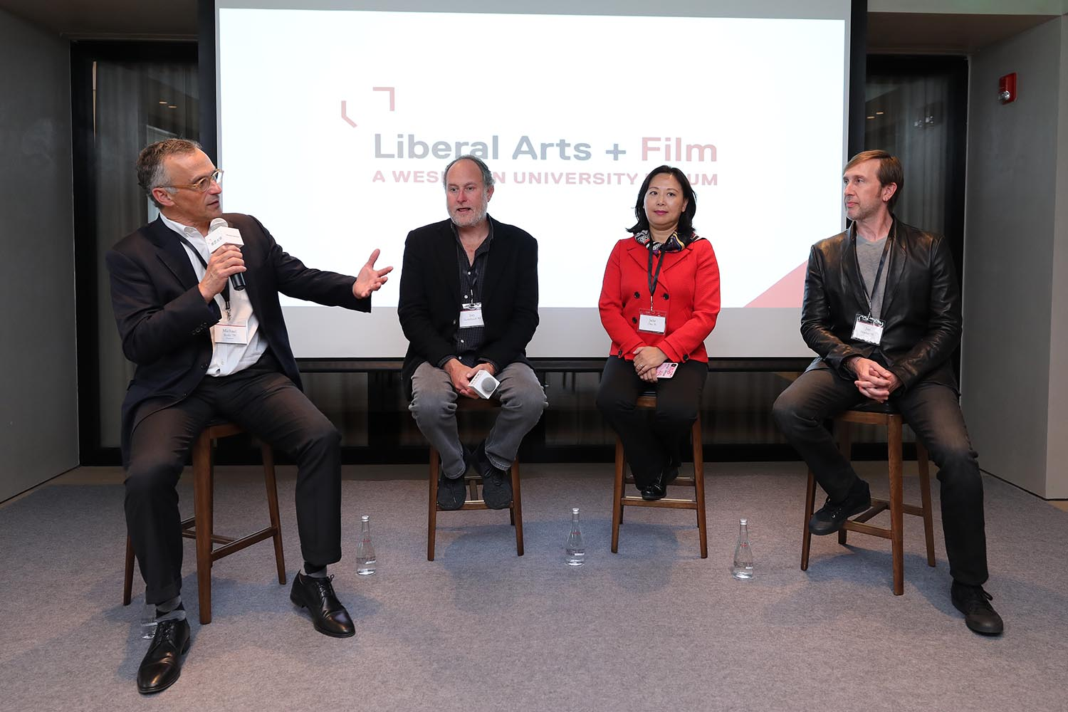 "President Michael Roth moderated a discussion with alumni in the entertainment field, from left, Jon Turteltaub '85, Julia Zhu '91, and Jon Hoeber '93, on ""practical idealism in action"" at the inaugural Liberal Arts + forum in Shanghai on Oct. 20."