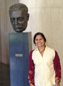 Ishita Mukerji with the bust of Dr. Homi Bhabha, founder of the Tata Institute for Fundamental Research.