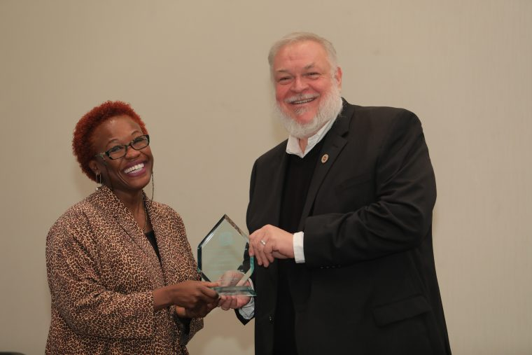 Gina Athena Ulysse accepted the Anthropology in Media Award (AIME) from American Anthropological Association President Alex Barker in November.