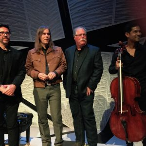 Chernoff, second from right, at the concert November 10. He is pictured on stage with, from left, composer Felipe Perez Santiago, composer Graham Reynolds, and cellist Jeffrey Zeigler.