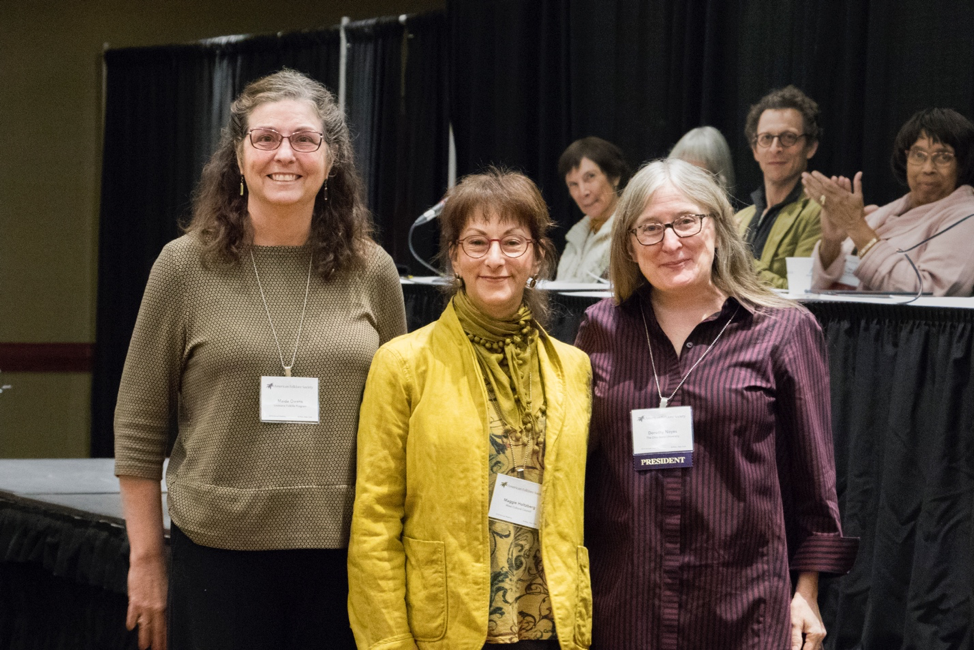 Past prize winner Maida Owens (left) and AFS President Dorothy Noyes present Maggie Holtzberg (center) with the 2018 Benjamin A. Botkin Prize at the Annual Meeting of the American Folklore Society in Buffalo, New York. Photo credit: Meredith A. McGriff.