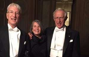 Gary Yohe, left, with Nobel Prize winner Bill Nordhaus, right, and his wife, Barbara, center, at Nobel Week in Stockholm, Sweden.