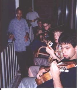 "This particular night some of us gathered in front of the dorms. We are playing the cuatro (south American 'ukulele/guitar'), American banjo, violin, and tin can!"" - Christopher Moscate, CCY '98"