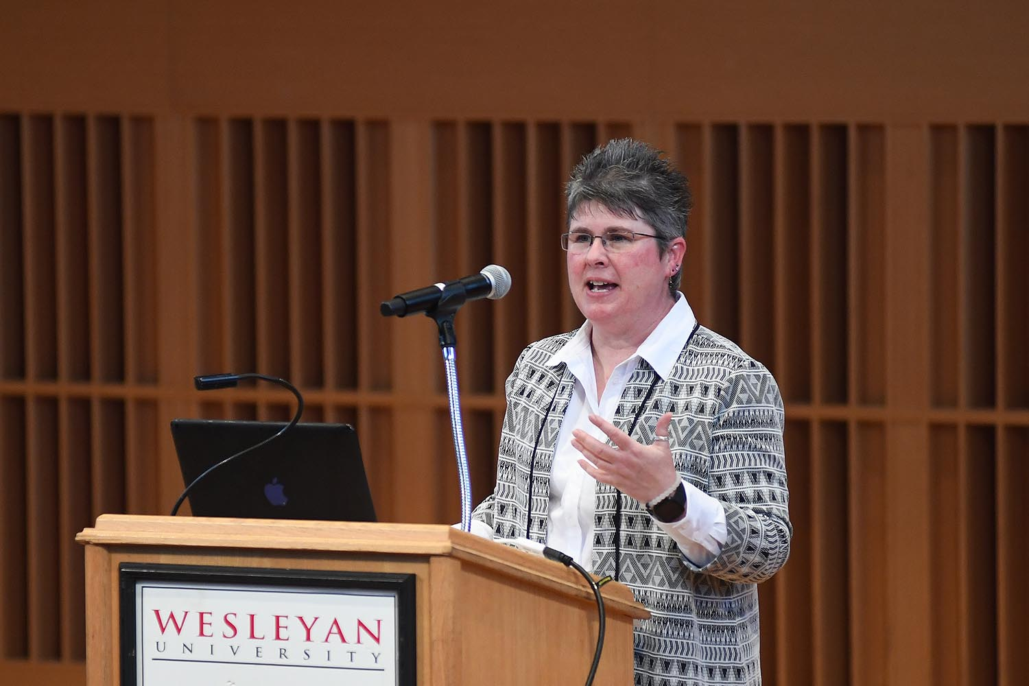 Debbie Colucci, Interim vice president for equity and inclusion, and equity compliance director and deputy title IX coordinator welcomed the audience to Wesleyan's MLK Day celebration.