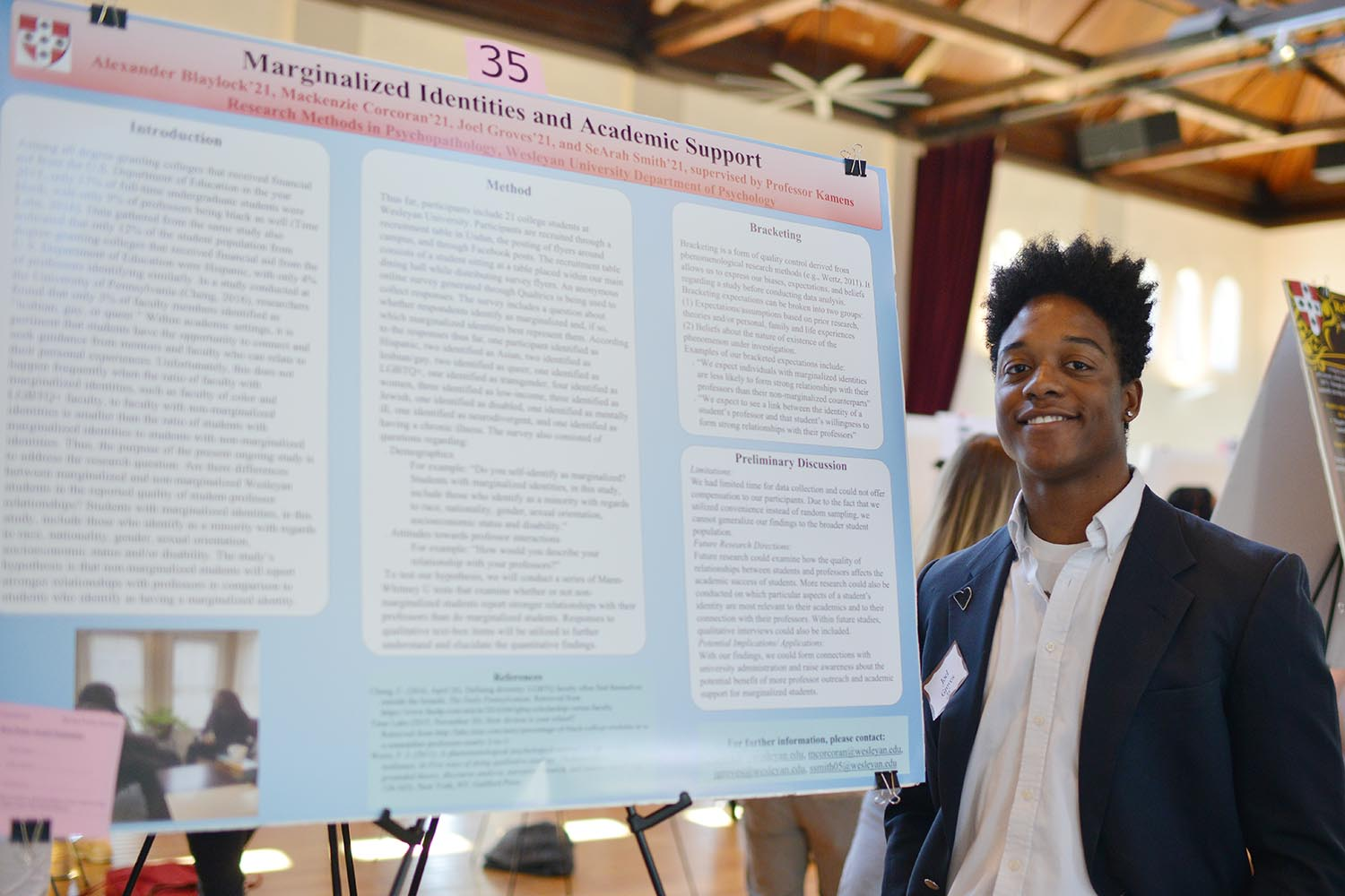"Joel Groves presented his group's poster titled ""Marginalized Identities and Academic Support ."" His advisor is Sarah Kamens."