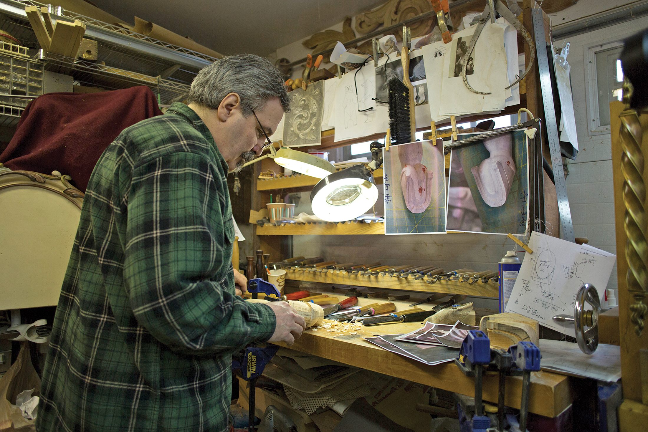 In his workshop, he carves a new leg and hoof for an antique carousel horse. (Photo by Melissa Rocha)