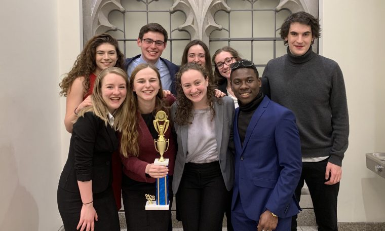 Wesleyan's Mock Trial A Team poses with their National-qualifier trophy at the Chestnut Hill Opening Round Championship Series in March 2019. The team is ranked 25th in the country.