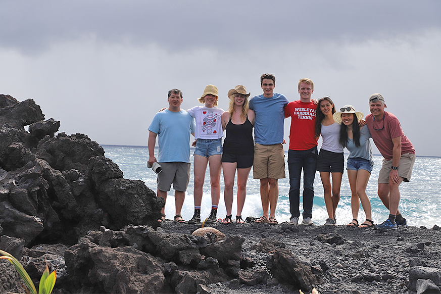 Left to right: Tim Ku (faculty), Celeste Smith, Jacqueline Buskop, John Sheffer, Ryan Nelson, Sara Wallace-Lee, Kelly Lam, and Phil Resor (faculty) at a newly formed black sand beach on Hawaii. The rocks on the left solidified in 2018.