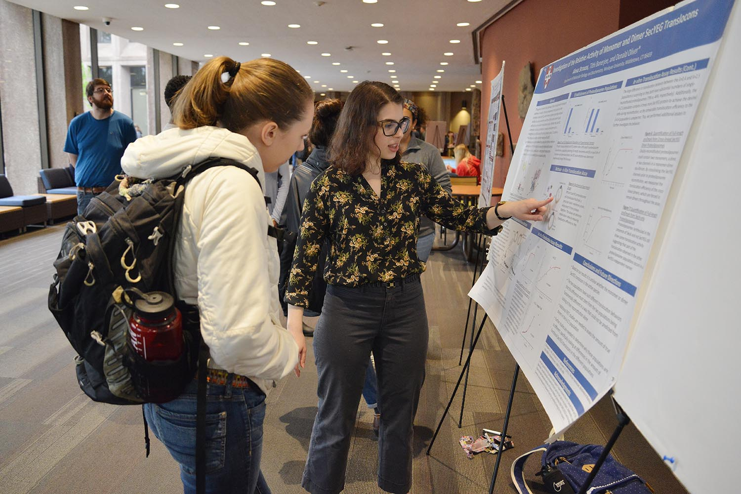 "Alexa Strauss presented her ""Investigation of the Relative Activity of Monomer and Dimer SecYEG Translocons."" Her advisor is Donald Oliver."
