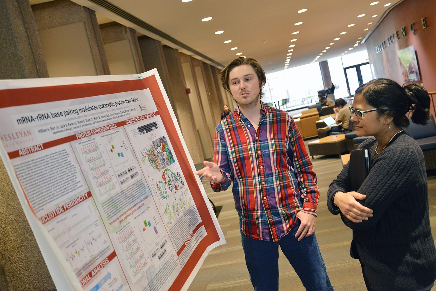 """BA/MA graduate student Will Barr shared his poster titled """"mRNA-rRNA Base Pairing Modulates Eukaryote Protein Translation"""" with Ishita Mukerji, theFisk Professor of Natural Science and professor of molecular biology and biochemistry.Barr's advisor is Michael Weir, professor of biology."""