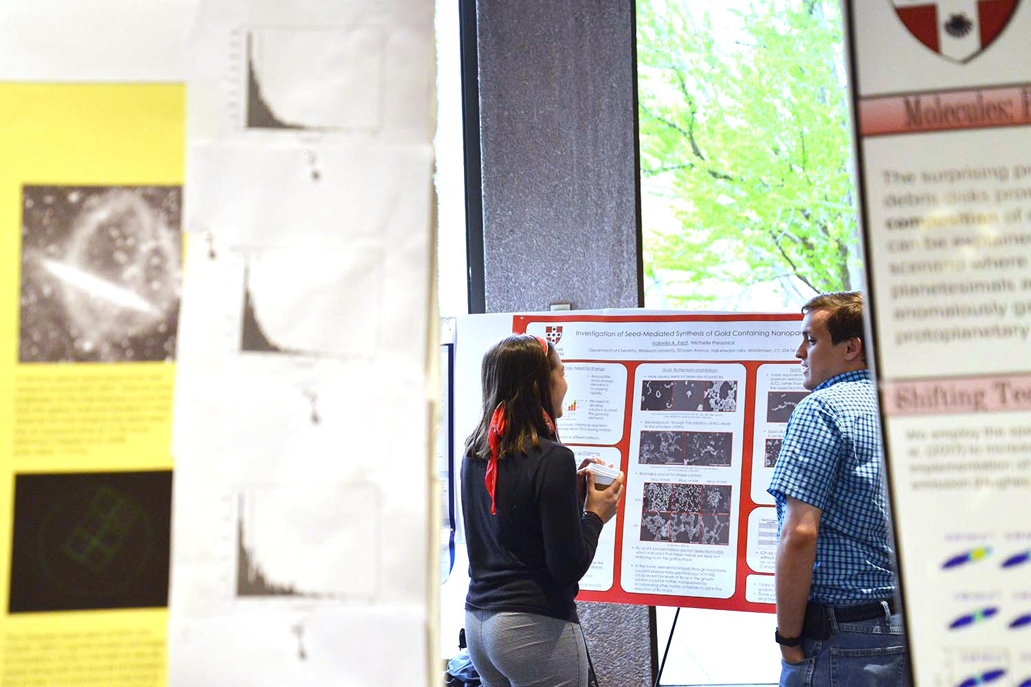 "Isabella Kent shared her poster titled ""Investigation of Seed-Medicated Synthesis of Gold Containing Nanoparticles."" Her advisor is Michelle Personick."