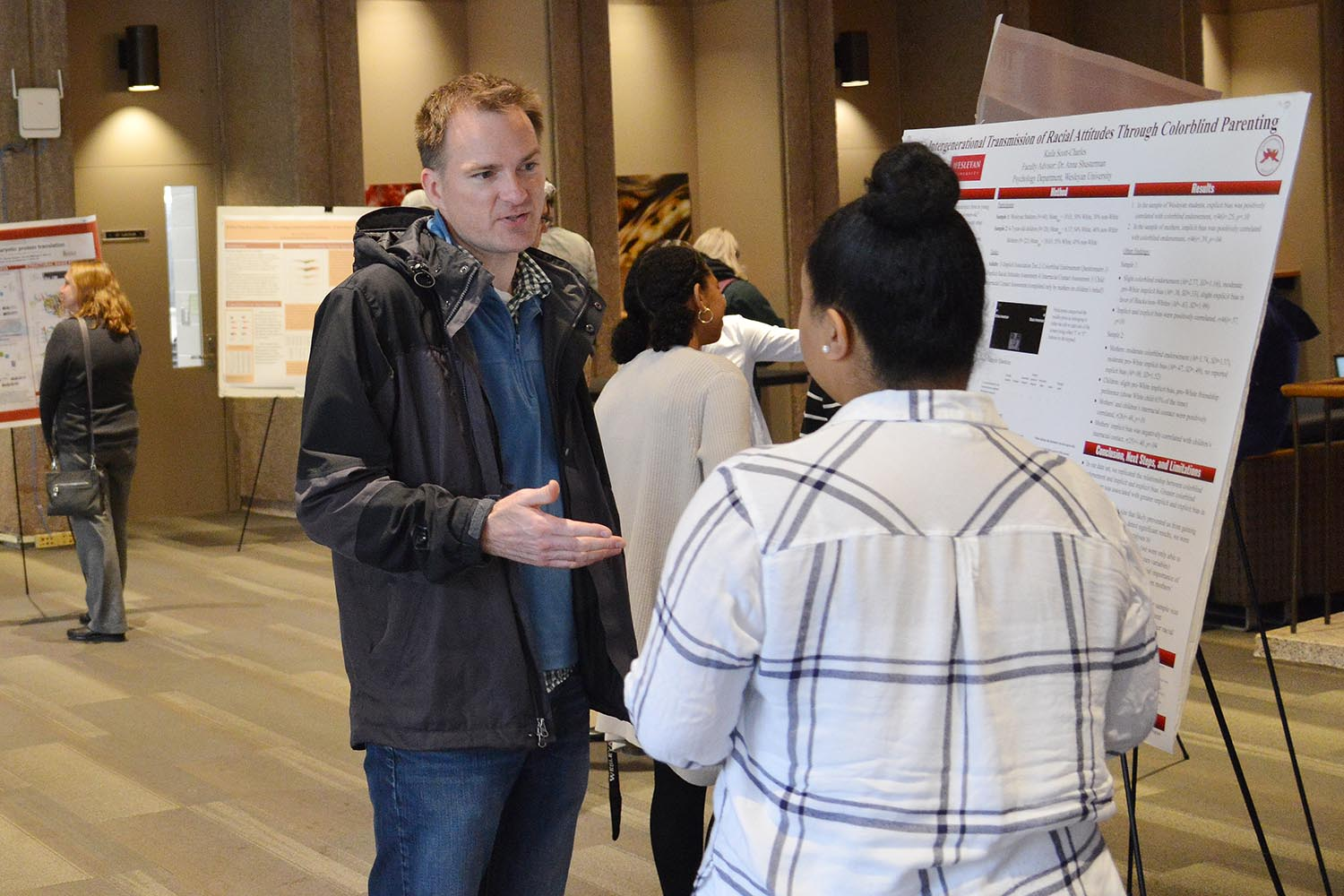 "Seth Redfield, chair and associate professor of astronomy, speaks to Kaila Scott '19 about her study titled ""The Intergenerational Transmission of Racial Attitudes: The Effects of Colorblind Parenting."" Scott's advisor is Anna Shusterman, associate professor of psychology."