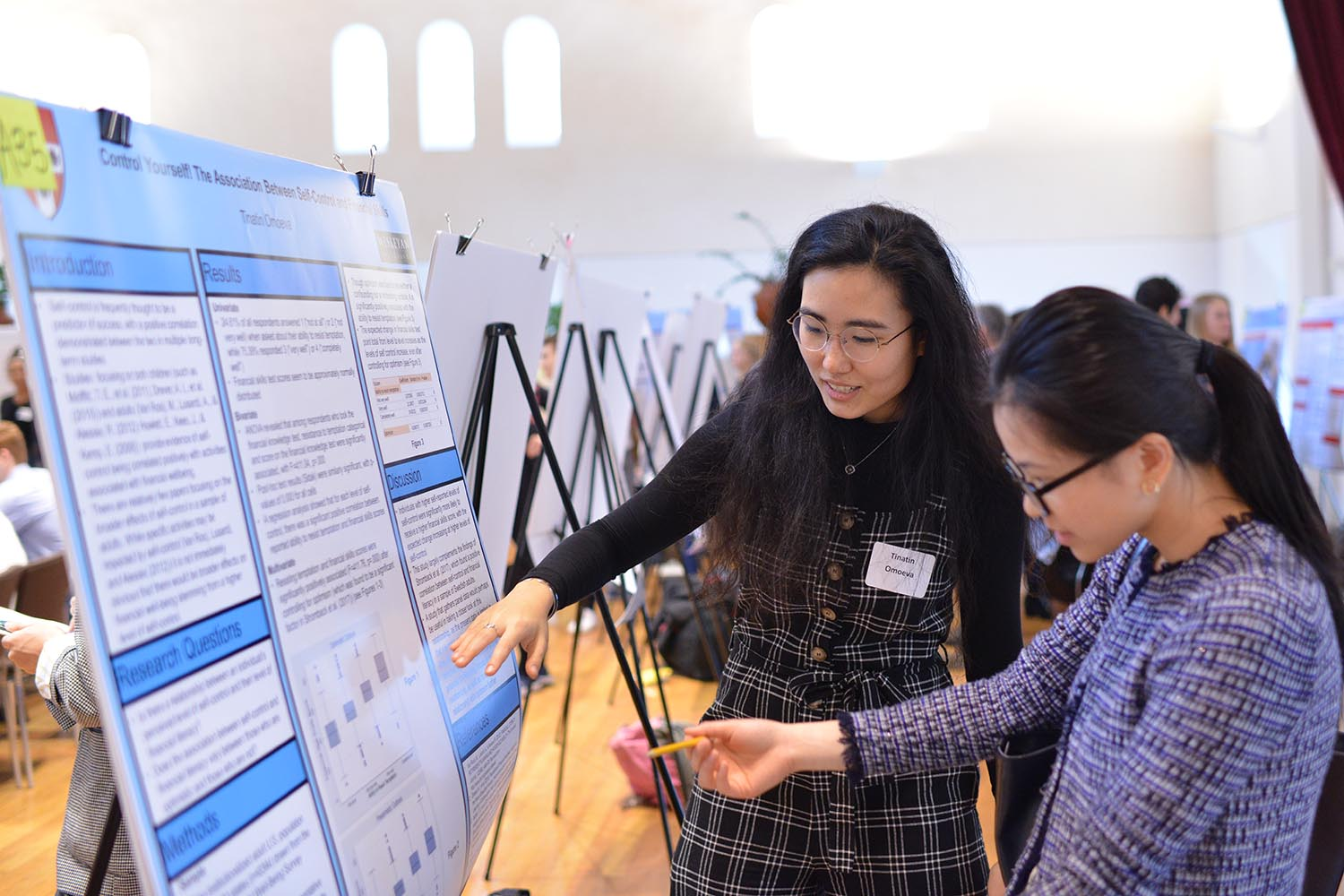 "Tinatin Omoeva '21 discussed her poster called, ""Control Yourself! The Association Between Self-Control and Financial Skills."""
