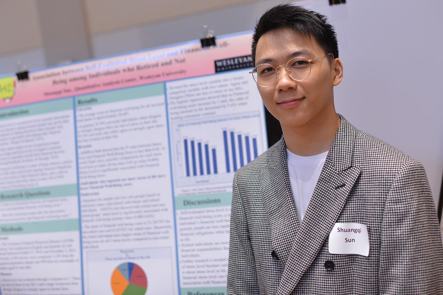 "Shuangqi Sun '21 presented his poster about ""The Association between Self-Evaluated Stress Level and Financial Well-Being among Individuals who Retired and Not."""