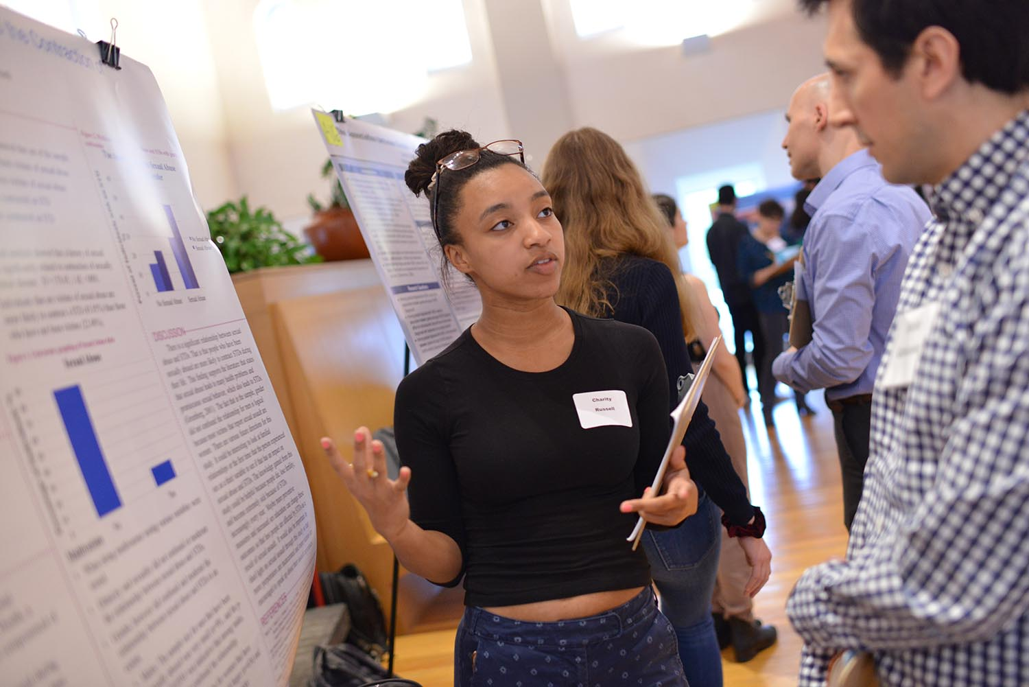 "Charity Russell '21 presented her poster titled, ""The Association between Sex Abuse and the Contraction of Sexually Transmitted Disease."""
