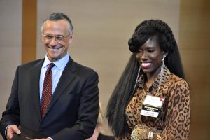 President Roth and Bozoma Saint John '99 smile on stage.