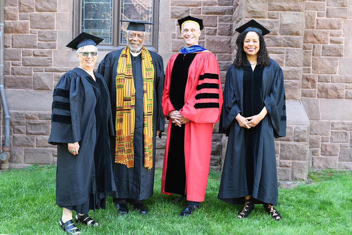 Wesleyan President Michael Roth '78 and Board of Trustees Chair Donna Morea congratulate honorary degree recipients Saidiya Hartman '84, Hazel Carby, and Edwin Sanders II '69 at Wesleyan's 187th Commencement.