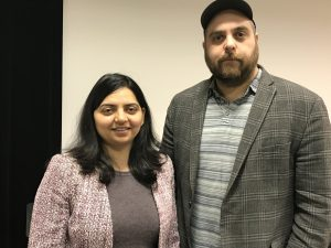 Visiting assistant professor Swapnil Rai stands beside her colleague from Boston College, alumnus Matt Sienkiewicz, who gave a guest lecture