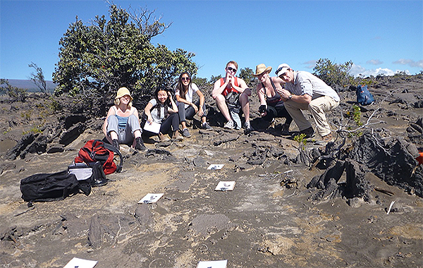 Senior Seminar (2019) posing around a trackway found in the Ka'u Ash Desert. From left to right: Celeste Smith, Kelly Lam, Sara Wallace-Lee, Ryan Nelson, Jacqueline Buskop, John Sheffer