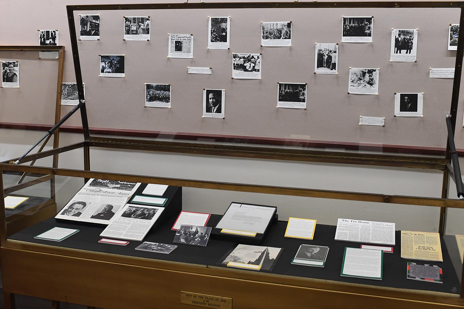 "An exhibit titled ""Through the Lens of History: The Wesleyan African American Experience"" is on display in Olin Library outside Special Collections & Archives."