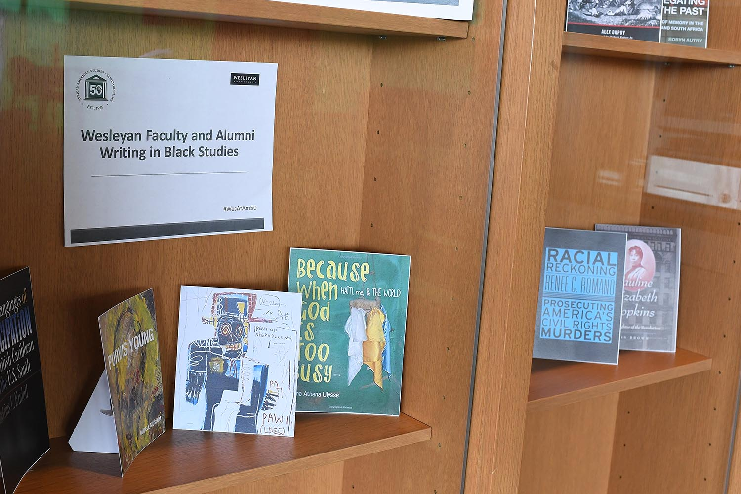 "The ""Books in Black Studies"" exhibit, located in Daniel Family Commons, features several book covers by Wesleyan faculty and alumni authors."