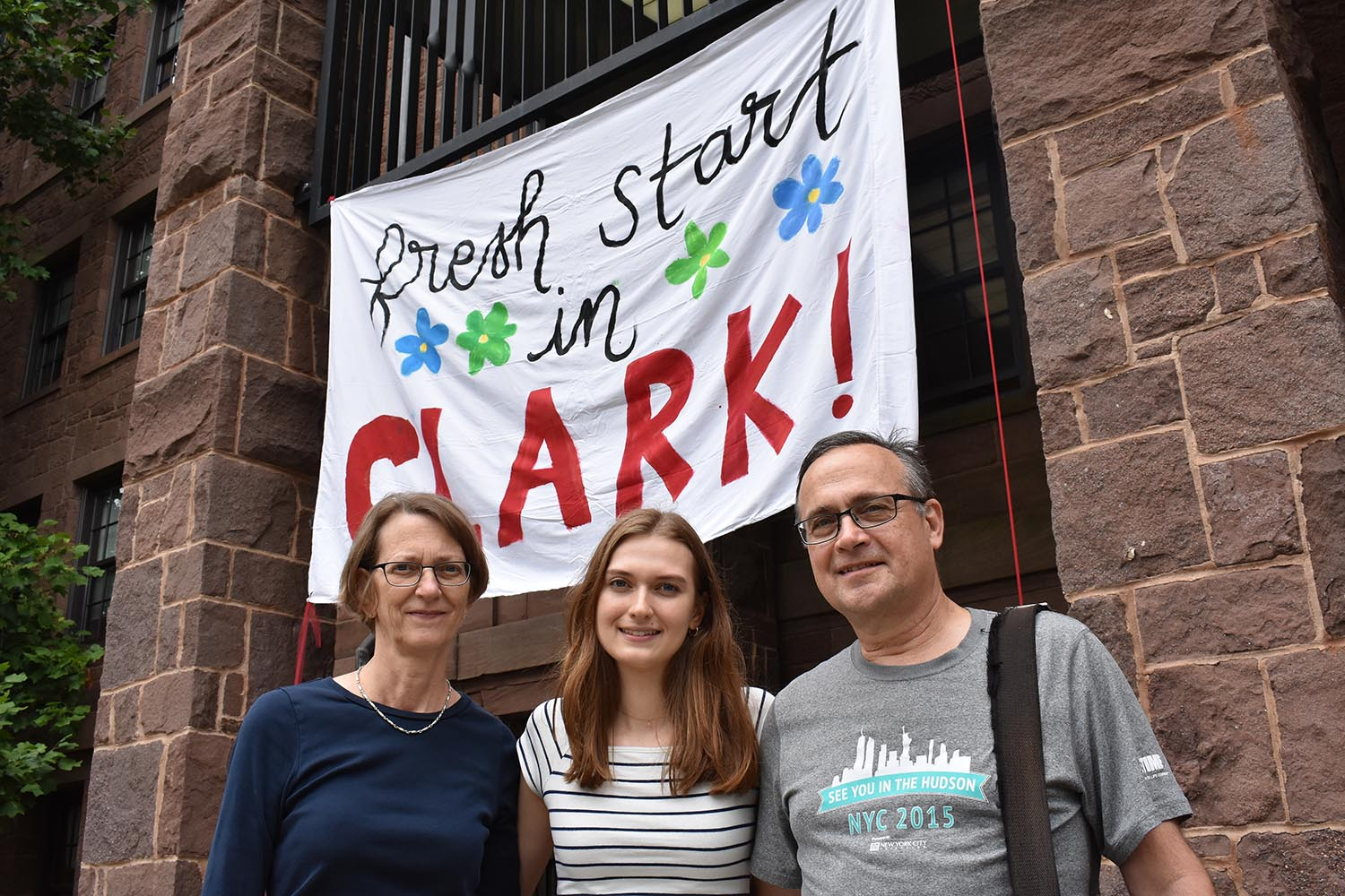 0134 Hannah Gonsher photographed with parents in front of Clark Hall sign (Cynthia might have more details)