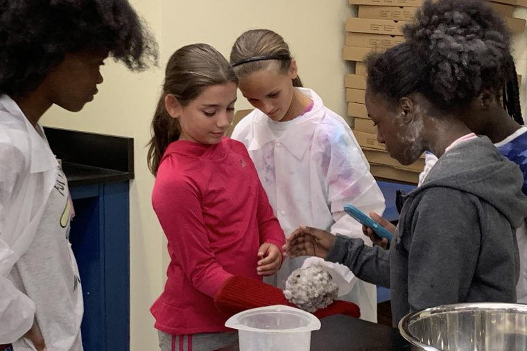 "Girls in Science participants observe a ""comet"" they created during the camp."