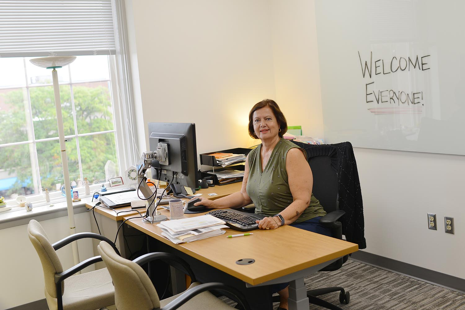 Olga Bookas, director of purchasing, enjoys her new office on the third floor.