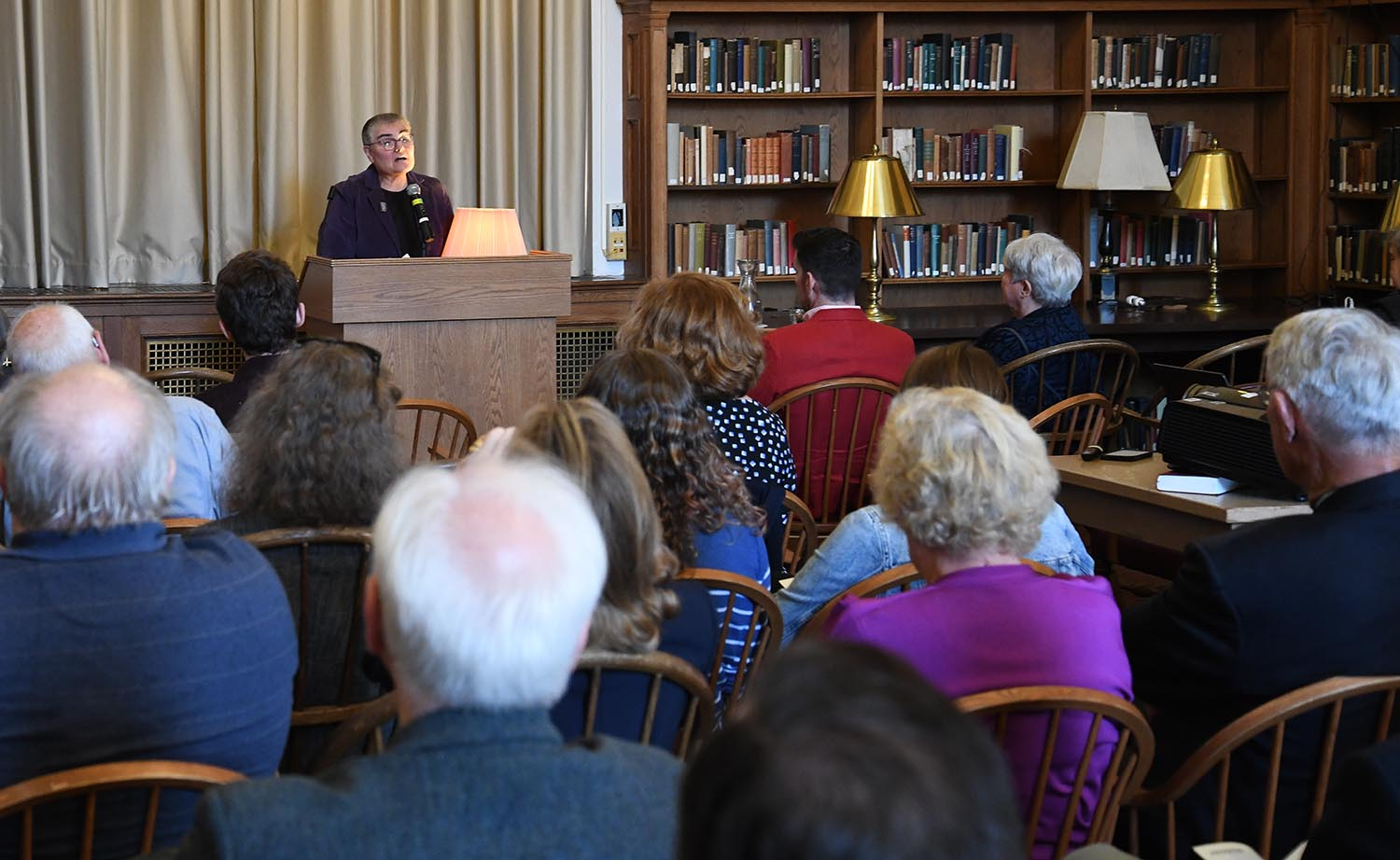 Director of Special Collections Suzy Taraba '77 MALS '10 addresses those in Smith Reading Room from the podium