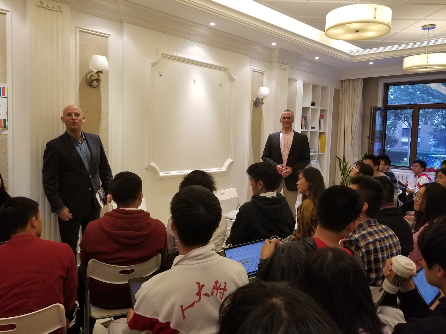 Rothschild, left, and Roth, right, speak to prospective students at Elite Scholars of China.