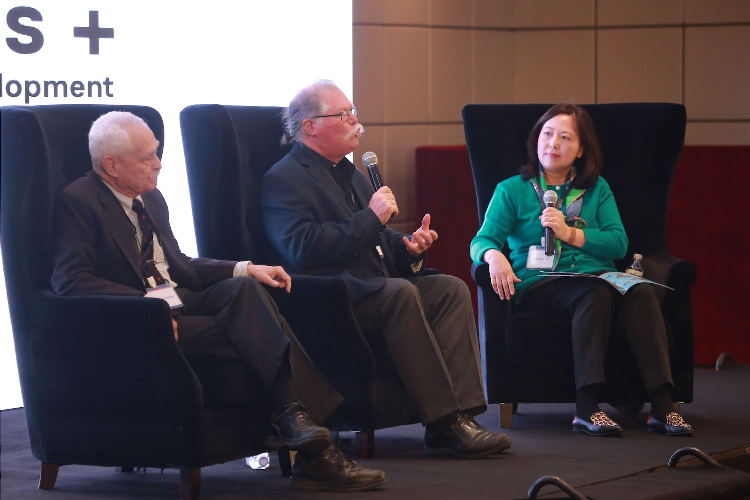 At the second annual Liberal Arts + forum in Beijing on Oct. 19, from left, Richard Adelstein, the Woodhouse/Sysco Professor of Economics, and Barry Chernoff, the Robert Schumann Professor of Environmental Studies, spoke on a panel moderated by Julia Zhu '91 about Wesleyan's unique interdisciplinary approach to teaching economics and environmental studies.