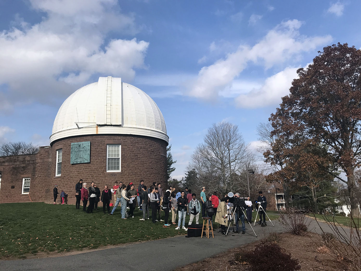Visitors use telescopes outside observatory